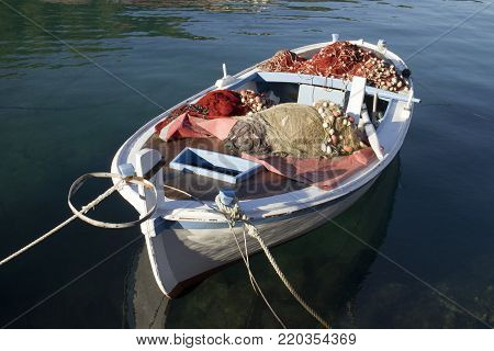 Fishing nets on deck of wooden fishing boat with nets