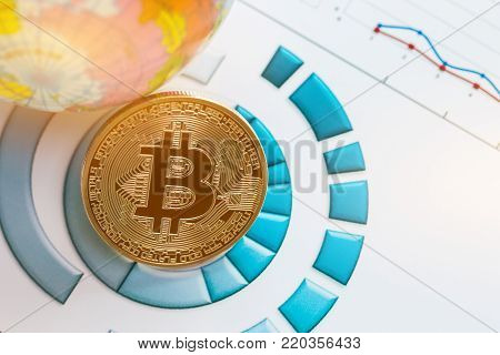Bitcoin digital currency, modern of Exchange Digital money, Gold Bitcoins with B letter symbol on report chart near earth model. Cryptocurrency can uses currencies, virtual currencies on web markets