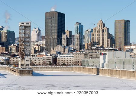 Montreal, Ca - 1 January 2018: Montreal Skyline And Frozen St Lawrence River In Winter
