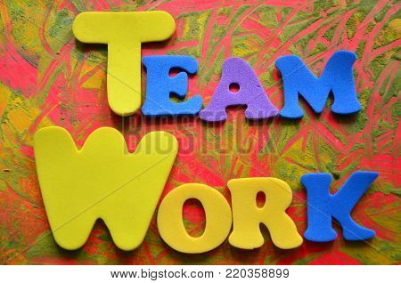 word team work on an abstract colored background