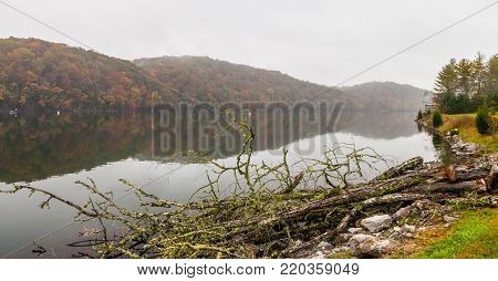 Melton Hill Dam with view of Clinch River with fall color