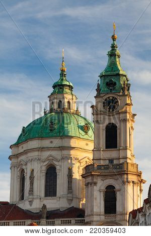 St. Nicholas Church at the Mala Strana District (Lesser Town) at sunrise, in Prague, Czech Republic.