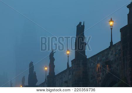 On the famous Charles Bridge in the morning mist, Prague, Czech Republic