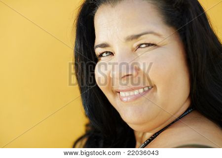 Mature Hispanic Woman Smiling At Camera
