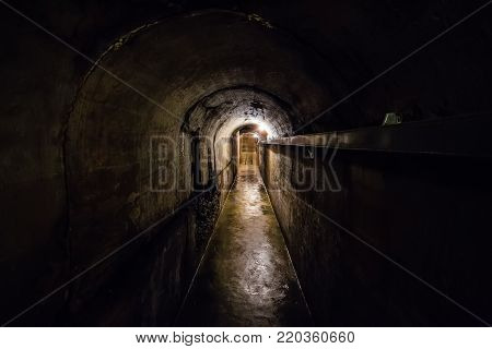 Dark corridor of old underground Soviet bunker under artillery fortification, Sevastopol, Crimea