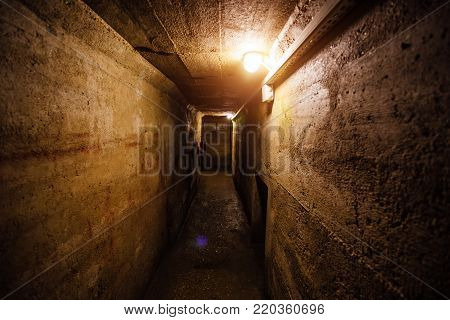 Dark corridor of old underground Soviet bunker under military artillery fortification, Sevastopol, Crimea