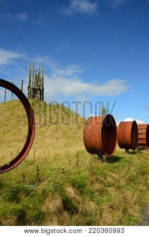An avenue of machinery parts and an artificial hill form part of an abandoned opencast mining regeneration plan in Fife