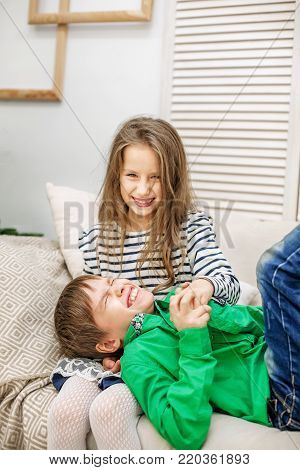 The Little Boy Gives A Girl A Rose. Two Children. The Concept Of