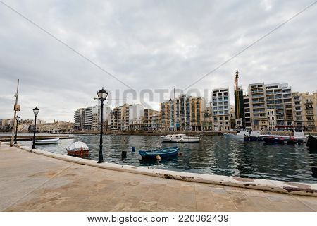 Rainy landscape of St. Julian's bay on Malta island. Beautiful seascape in south Europe.