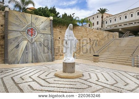 NAZARETH, ISRAEL - DECEMBER 18: statue of the Virgin Mary in the courtyard of the Basilica of the Annunciation in Nazareth, Israel on december 18, 2017. This church was built on the site where according to Tradition was the home of the Virgin Mary