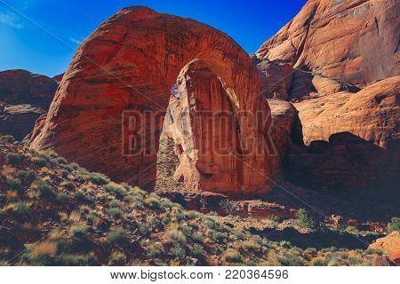 Beautiful rock formation in Glen Canyon near Lake Powell, Utah. Rocks formed unbelievable bridge called Rainbow Bridge National Monument.
