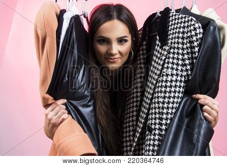 girl looking and choosing what to wear in her wardrobe nothing to wear concept