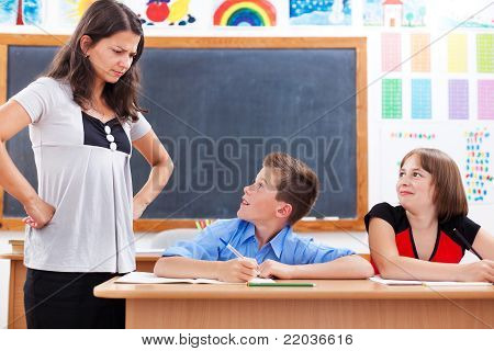 Angry Teacher Looking At Scared Boy