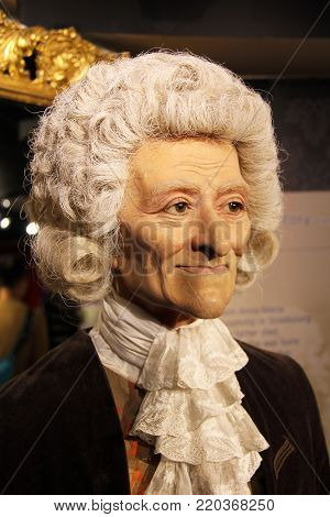 London, - United Kingdom, 08, July 2014. Madame Tussauds in London.  Waxwork statue of Franois Marie Arouet, also known as Voltaire