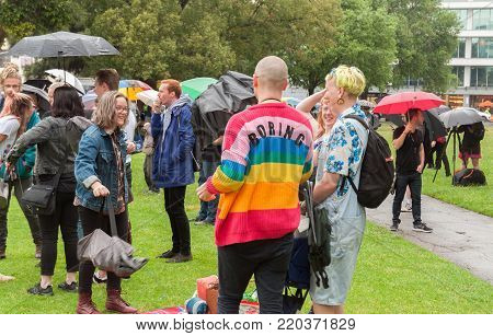 Adelaide, AU - November 15, 2017: Supporters wait patiently in the rain at Hindmarsh Square to hear the result of the Australian Postal Survey on Marriage Equality.
