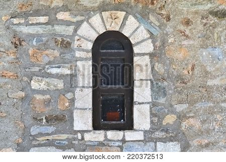 Detail of the facade with arched window of an old house in Ohrid - Macedonia