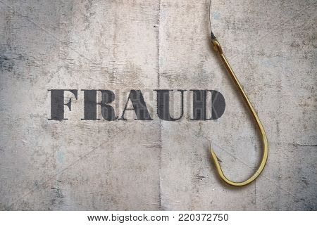 Word Fraud and a fishing hook on vintage background