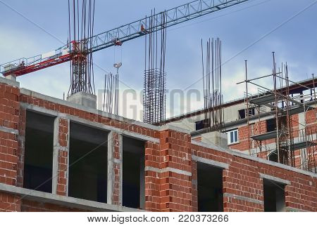 Detail of a construction site and a new unfinished building