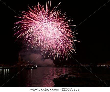 Big red fireworks explode in Venice in dark sky,New Year fireworks in Venice fireworks explode, New Year, Venice,