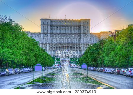 Amazing sunset behing the famous building of Parliament in Bucharest capital, one of the biggest architecture of the world