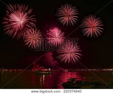 Big red fireworks explode in Venice in dark sky,New Year fireworks in Venice, 4 July, Independence, fireworks explode, New Year, Venice, Italy 2018