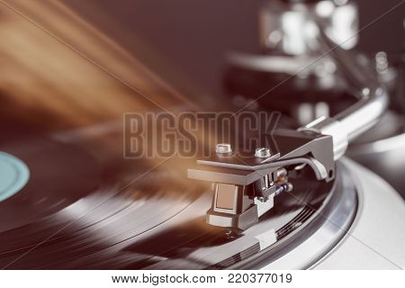 vintage high end turntable in action closeup