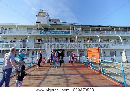 Rybinsk, Russia. - June 3.2016. Passenger ship October Revolution is moored at the pier of the town of Rybinsk. Close-up entrance to the moored steam-ship.