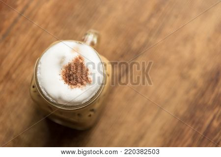 Iced Cappuccino on the wood table in coffee shop restaurant has ready to served in the morning with relaxing and break time.