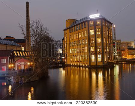NORRKOPING, SWEDEN - DEC 31, 2017: Nightscape of the beautiful building Arbetets museum Strykjarnet / Museum of Work, built in the river Motala Strom in central Norrkoping in Sweden, December 31, 2017