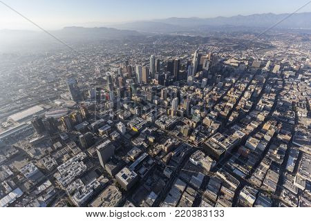 Aerial view of urban downtown streets and buildings in Los Angeles, California.