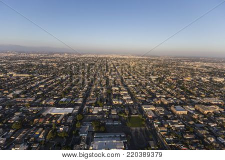 Late afternoon aerial view of buildings and streets in south Los Angeles, California.