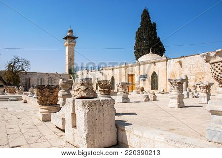 JERUSALEM, ISRAEL - AUGUST 05, 2010: Wide angle picture of the tower of Al Aqsa Mosque and old pillars located inside the walls of Old Jerusalem, Israel.