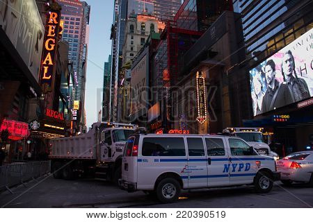 Manhattan, New York, December 31, 2017: Theater District next to Times Square with NYPD car and trucks on West 42nd street