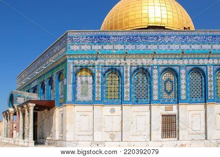 Horizontal picture of muslim people walking in front of Al Aqsa Mosque located inside the walls of Old Jerusalem, Israel.