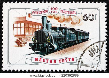 HUNGARY - CIRCA 1976: a stamp printed in Hungary shows steam engine no.17, 1885, and Rabatamasi station, centenary of Gyor-Sopron railroad, circa 1976