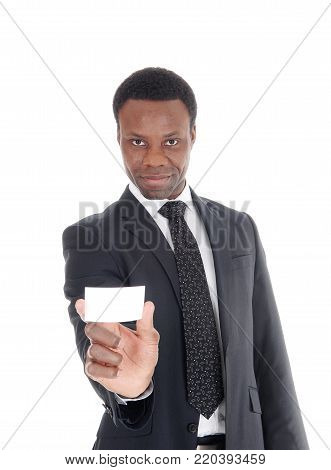 A handsome young African American businessman holding an empty businesscard, in suit and tie, isolated for white background