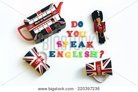 Colorful english words DO YOU SPEAK ENGLISH with souvenirs from London, English language learning concept.