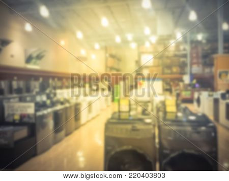 Blurred Retail Store With Rows Of Washing Machines At Retail Store