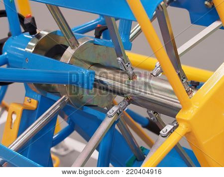 Blue industrial mechanical shaft and link contraption poster