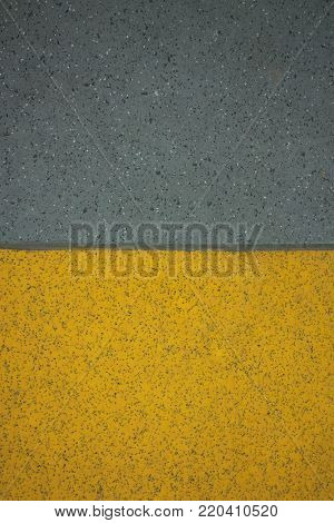 Yellow and grey non-slip safety flooring background in vertical 3:2 format.
