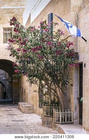 israeli flag in old town cobbled street scene in ancient jerusalem city israel