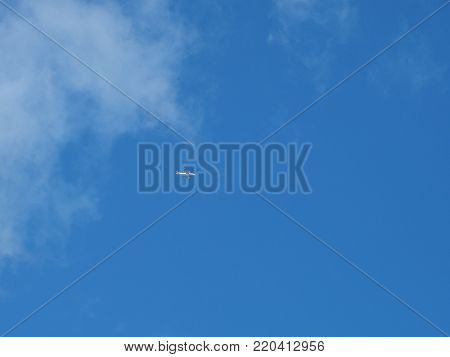 Striped pattern white clouds on blue sky with plane, The Hague 2017