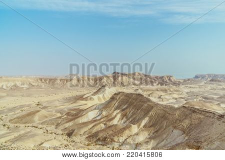 Landscape horizon view on dry desert and sky near the dead sea in Israel. Infinity valley panorama of lone sand, rocks, hills and stones. Waterless middle east territory, silence and heat.