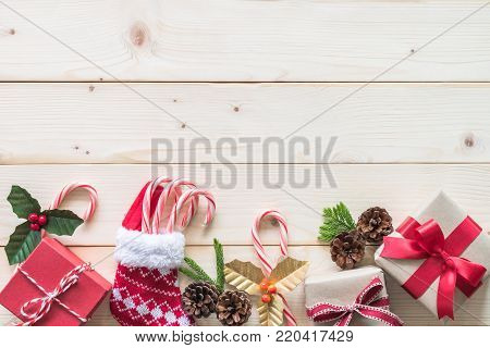 Christmas gift background with red box of present on white pine wood background for X'mas winter holiday backdrop and design decoration
