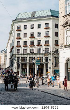 Vienna,  Austria - August 16, 2017: Street scene in Vienna in Michaelerplatz with Looshaus designed by Adolf Loos on background