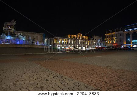 Beautiful scene of Kutaisi in a New Year night. City night plaza in autumn with paths strewn. Central night street