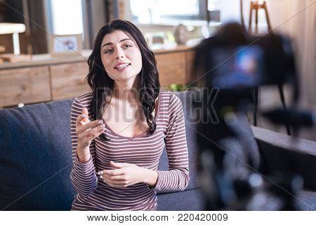 My experience. Beautiful nice attractive woman looking into the camera and telling a story while sharing her experience with viewers