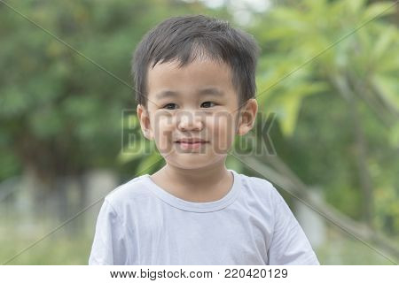 head shot  asian children smiling face with  happiness emotion