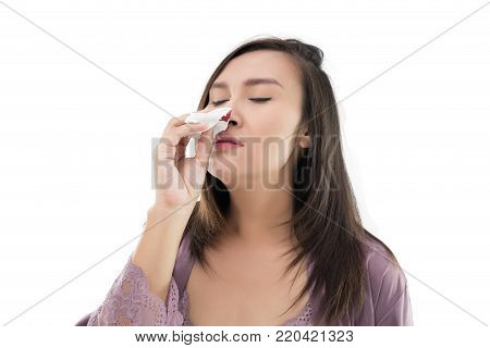 Asian women in satin nightwear with nosebleed isolate on white background, The asian people hurts her nose
