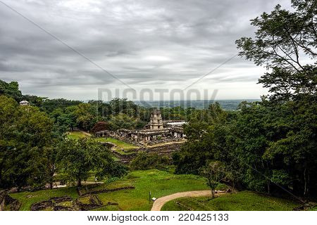 Panoramic vista of ancient Maya city state of Palenque covered with a green jungle